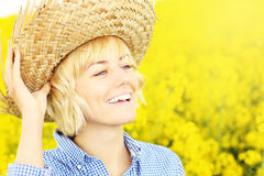 Happy woman on a yellow rape field Royalty Free Stock Images