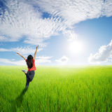 Happy woman in yellow rice field and Sun sky outdoor. Happy woman in yellow rice field and Sun sky.Summer Vacation concept Stock Photo