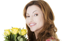 Happy woman with yellow roses Royalty Free Stock Photography