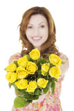 Happy woman with yellow roses Royalty Free Stock Photo