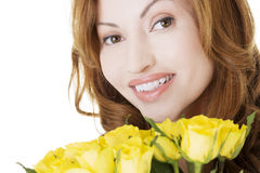 Happy woman with yellow roses Stock Photography
