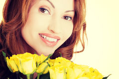 Happy woman with yellow roses Stock Images