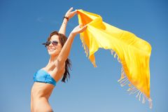 Happy woman with yellow sarong on the beach Royalty Free Stock Photography