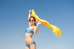 Happy woman with yellow sarong on the beach Royalty Free Stock Photo