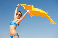 Happy woman with yellow sarong on the beach. Picture of happy woman with yellow sarong on the beach Stock Image