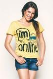 Happy woman in yellow top. In studio Stock Images