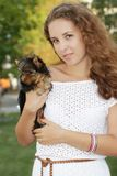 Happy woman with yorkshire terrier Royalty Free Stock Photography