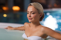 Happy womani sitting in jacuzzi at poolside Royalty Free Stock Images