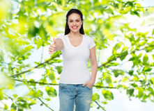 Happy womanin white t-shirt showing thumbs up Stock Photography