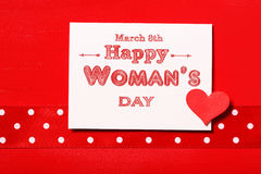 Happy Womans Day with red heart. Happy Womans Day message with red heart and polka dots ribbon Stock Photo