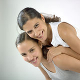 Happy women. A studio portrait of two beautiful young women. They are friends with a very expression on their faces Stock Image