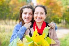Happy women in autumn  garden Stock Images