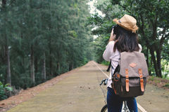 Happy women backpacker with shooting in nature background. Happy woman backpacker with shooting in nature background, Relax time on holiday concept travel color Royalty Free Stock Photos