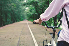 Happy women backpacker with white bicycle Stock Photos