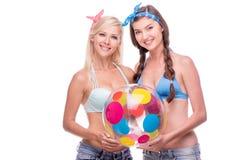 Happy women with beach ball, isolated Stock Photos