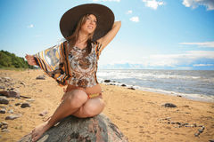 Happy women on the beach with hat Royalty Free Stock Photos