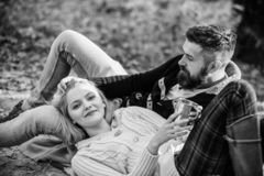 Happy woman and bearded man drink mulled wine. camping and hiking. cheers. love date and romance. Family picnic. Love. Happy women and bearded men drink mulled royalty free stock photos