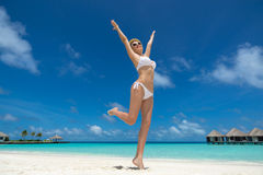 Happy women in bikini on tropical beach Royalty Free Stock Photography