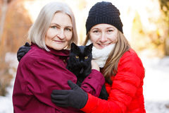 Happy women and the black cat Stock Photography
