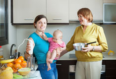 Happy women  with blender in  kitchen Royalty Free Stock Photo