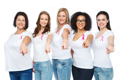Happy women with breast cancer awareness ribbons Stock Photo
