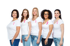 Happy women with breast cancer awareness ribbons Stock Photography