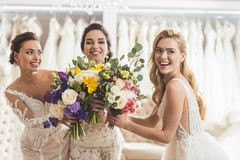 Happy women brides with flowers royalty free stock images