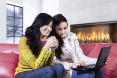 Happy women browsing internet at home Stock Images