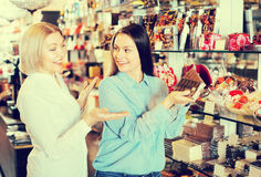 Happy women buying chocolate bars Royalty Free Stock Photography