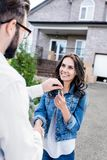 Happy woman buying new house and shaking hands. Happy women buying new house and shaking hands with realtor Stock Image