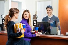 Happy Women Buying Tickets At Box Office Royalty Free Stock Photos