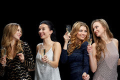 Happy women with champagne dancing over black Stock Image
