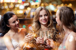 Happy women with champagne glasses at night club Stock Images