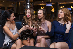 Happy women with champagne glasses at night club Stock Image
