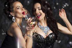 Happy Women - Champagne and Singing Xmas Song. Happy Laughing Women Drinking Champagne, Singing Xmas Song Royalty Free Stock Photo