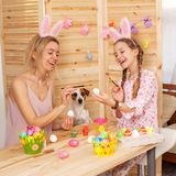 Happy woman with child paint easter eggs Royalty Free Stock Photography