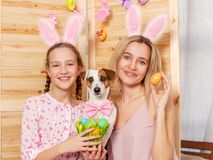 Happy woman with child paint easter eggs Royalty Free Stock Image