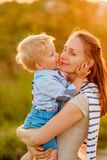 Woman and child having fun outdoors in sunset sunlight Royalty Free Stock Photos