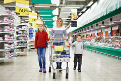 Happy women and children with cart shopping Royalty Free Stock Photo