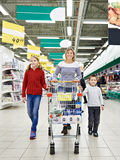 Happy women and children with cart shopping Stock Photos