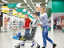 Happy women and children with cart shopping Stock Image