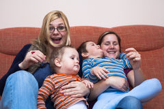 Happy women with children. Two happy women playing with children at home Stock Photo
