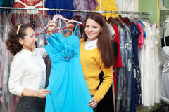 Happy women chooses blue dress Stock Photo