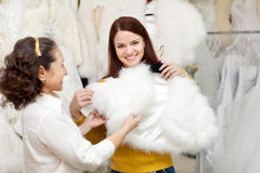 Happy women chooses bridal outfit at wedding store Stock Photography