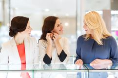 Happy women choosing earrings at jewelry store Royalty Free Stock Image
