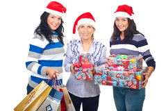 Happy women with Christmas presents. Happy three women holding Christmas presents isolated on white background Royalty Free Stock Photo