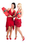 Happy women with Christmas presents Royalty Free Stock Images