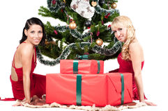 Happy women with Christmas presents Royalty Free Stock Image