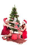 Happy women with Christmas presents Stock Image