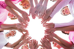 Happy women in circle wearing pink for breast cancer Royalty Free Stock Photo